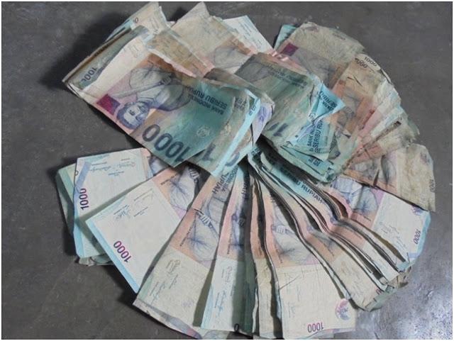 Barang Bukti Uang Pecahan Seribuan Dari Tangan Empat Penjudi yang Digerebek
